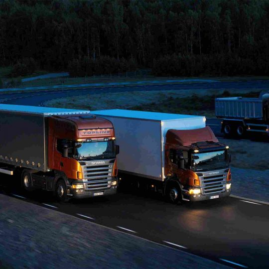 https://angel-repatriation.com/wp-content/uploads/2015/09/Three-orange-Scania-trucks-540x540.jpg